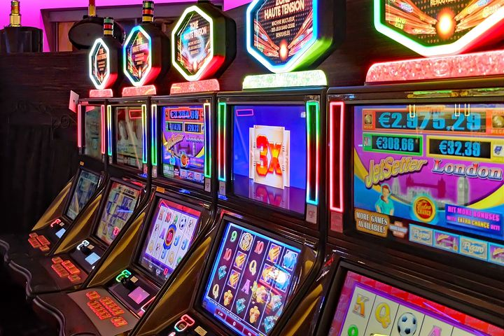 four slot machines sitting along a wall
